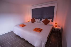 The Original Orange Hotel, Отели  Накхонситхаммарат - big - 6