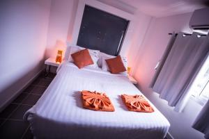 The Original Orange Hotel, Отели  Накхонситхаммарат - big - 24
