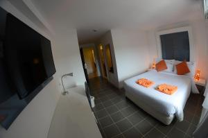 The Original Orange Hotel, Отели  Накхонситхаммарат - big - 23
