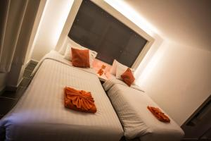The Original Orange Hotel, Отели  Накхонситхаммарат - big - 2