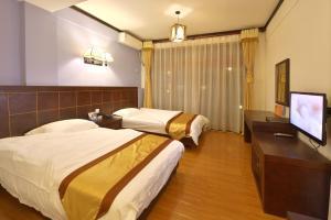 Kongquegu Hostel, Ostelli  Jinghong - big - 5