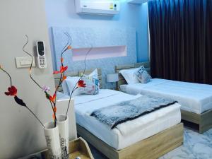 Dvoulůžkový pokoj typu Superior s manželskou postelí nebo oddělenými postelemi