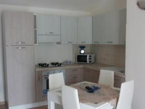 Appartamenti Isola Rossa - AbcAlberghi.com