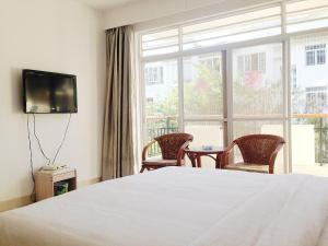 Golden Tiandi Holiday Apartment Bao'an Jiangnan City, Appartamenti  Haikou - big - 28