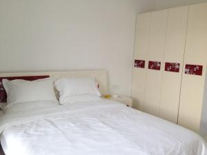 Golden Tiandi Holiday Apartment Bao'an Jiangnan City, Appartamenti  Haikou - big - 29