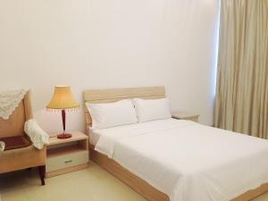 Golden Tiandi Holiday Apartment Bao'an Jiangnan City, Appartamenti  Haikou - big - 31