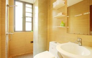 Golden Tiandi Holiday Apartment Bao'an Jiangnan City, Appartamenti  Haikou - big - 32