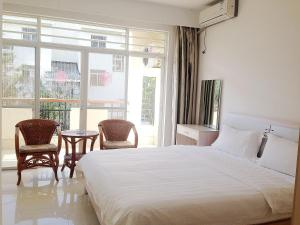 Golden Tiandi Holiday Apartment Bao'an Jiangnan City, Appartamenti  Haikou - big - 34