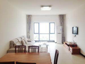 Golden Tiandi Holiday Apartment Bao'an Jiangnan City, Appartamenti  Haikou - big - 3