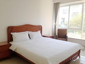 Golden Tiandi Holiday Apartment Bao'an Jiangnan City, Appartamenti  Haikou - big - 2