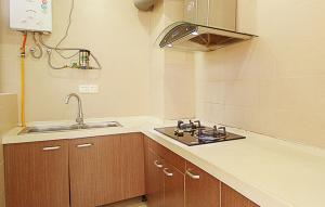 Golden Tiandi Holiday Apartment Bao'an Jiangnan City, Appartamenti  Haikou - big - 35