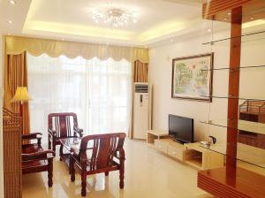 Golden Tiandi Holiday Apartment Bao'an Jiangnan City, Appartamenti  Haikou - big - 19