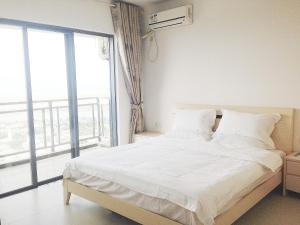 Golden Tiandi Holiday Apartment Bao'an Jiangnan City, Appartamenti  Haikou - big - 13