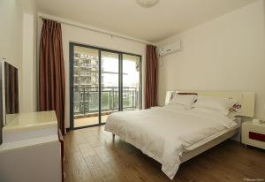 Golden Tiandi Holiday Apartment Bao'an Jiangnan City, Appartamenti  Haikou - big - 12
