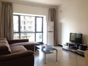 Golden Tiandi Holiday Apartment Bao'an Jiangnan City, Appartamenti  Haikou - big - 42