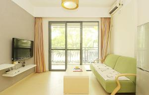 Golden Tiandi Holiday Apartment Bao'an Jiangnan City, Appartamenti  Haikou - big - 8