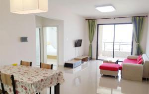 Golden Tiandi Holiday Apartment Hainanzhixin, Appartamenti  Haikou - big - 2