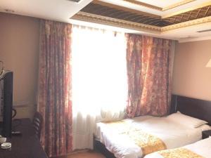 Qingdao Huangjia Garden Business Hotel, Hotels  Qingdao - big - 3