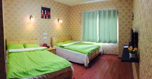 Daocheng Yading Baimaoniu Hotel