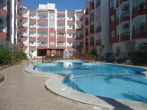 Apartment at nice resort with pool, Ferienwohnungen  Hurghada - big - 14