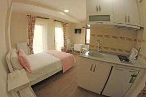 Ede Apart Otel, Aparthotels  Geyikli - big - 32