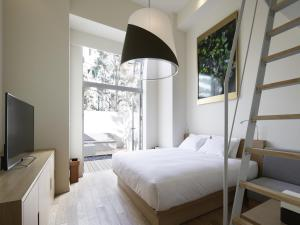 Luxury Triple Room with Loft and Terrace - Ground Floor - Non-Smoking