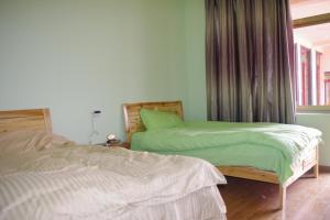 Yiwo Inn, Ubytování v soukromí  Lhasa - big - 21
