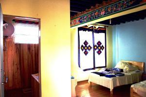 Yiwo Inn, Ubytování v soukromí  Lhasa - big - 26