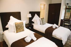 Mackaya Bella Guest House, Penzióny  Durban - big - 10