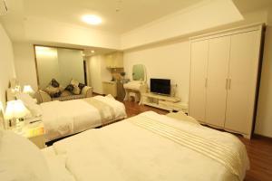 Foshan Keruisi Apartment (Nanhai Wanda SOHO Branch), Апартаменты  Фошань - big - 6
