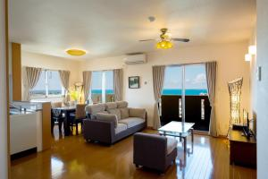 United Resort Yomitan, Апартаменты  Yomitan - big - 9