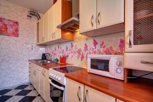 Apartment at Prospekt Bolshevikov, Ferienwohnungen  Sankt Petersburg - big - 11