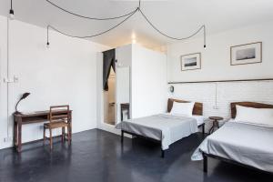 Pokoj typu Standard se 2 manželskými postelemi velikosti Queen