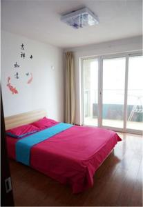 U Home Apartment Qingdao Aibi'an Branch, Apartmanok  Huangtao - big - 14