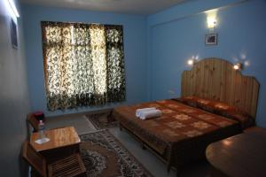 Malis Apple Lodge, Bed and breakfasts  Nagar - big - 3