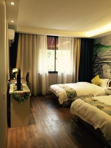 Guilin Recollection Inn, Alloggi in famiglia  Guilin - big - 6