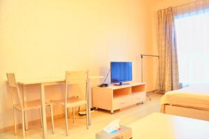 China Sunshine Apartment Dacheng, Apartmány  Peking - big - 14