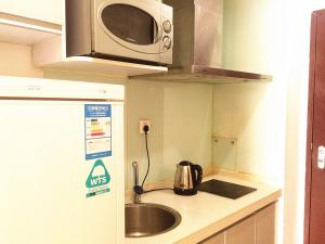 China Sunshine Apartment Dacheng, Apartmány  Peking - big - 31