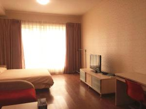 China Sunshine Apartment Dacheng, Apartmány  Peking - big - 39