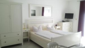 Familien- und Apparthotel Strandhof, Hotely  Tossens - big - 11