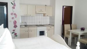 Familien- und Apparthotel Strandhof, Hotely  Tossens - big - 12