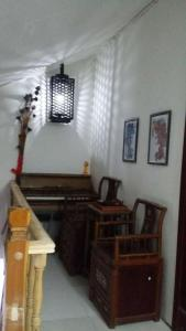 Wenxi Homestay, Privatzimmer  Kaifeng - big - 24