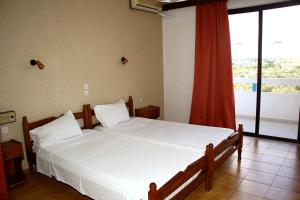 Karavos Hotel Apartments, Aparthotels  Archangelos - big - 6