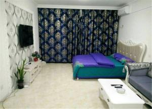 Dalian 8090 Fashion Apartment Times Plaza, Ferienwohnungen  Jinzhou - big - 3