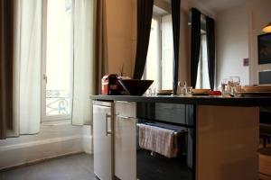 Appart' Sathonay, Apartmanok  Lyon - big - 13