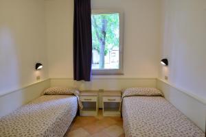 Camping Bella Italia, Комплексы для отдыха с коттеджами/бунгало  Пескьера-дель-Гарда - big - 17