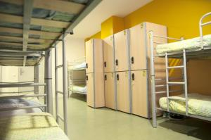One Bed in a 12-Bed Shared Dormitory