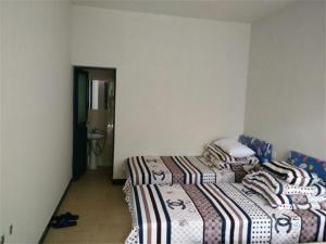 Xuancheng Jixi Enji Inn, Affittacamere  Jixi - big - 9