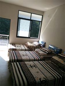 Xuancheng Jixi Enji Inn, Affittacamere  Jixi - big - 2