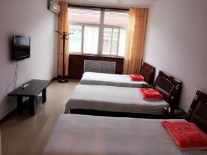 Huangcheng Xiangfu 805 Family Inn, Penzióny  Yangcheng - big - 5
